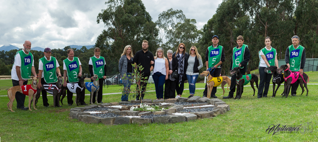 The eight runners of the Brian Davis Memorial around the black and white garden in Brian's honour.